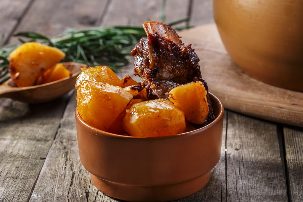 meat and potatoes baked in a pot